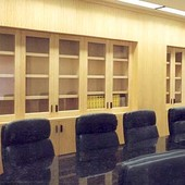Conference Room with bookcases, cabinets and panelling, granite conference table