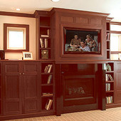 Bookcases and Fireplace Surround, built-ins: stained walnut.