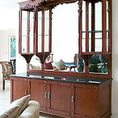 Buffet/Display Case, freestanding: stained and glazed cherry with hand carved ac