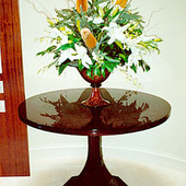 Entrance Hall Table, freestanding: stained ribbon stripe mahogany with hand rubb