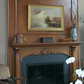 Fireplace Surround, built-in: stained and glazed cherry with carved accents.