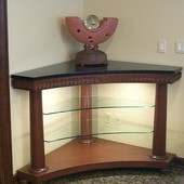 Display table:  Granite, glass, stained mahogany.