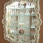 Display Cabinet, wall hung: glass, mirror, lacquered finish.