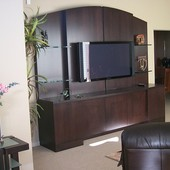 Entertainment Center: Glass, ribbon stripe mahogany