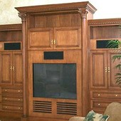 Entertainment Center, freestanding: stained and glazed maple with carved accents