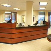 Reception Desk, built-in: granite, stained maple with black lacquer accents.