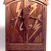Armoire, freestanding: natural cherry and maple with hand carved relief.