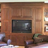 Wainscoted Room with Bookcases and TV Cabinet, built-in: stained walnut.