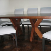 Dining table: stained walnut.