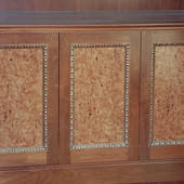 Walnut frame with sliver leafed effect accent moldings and natural olive ash bur